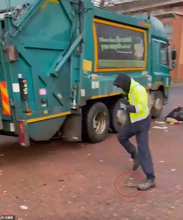 The rat runs towards one of the bin men who screams out as the rodent approaches his foot