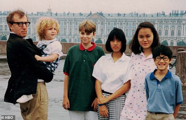 New HBO documentary, Allen v. Farrow, features never-before-seen home videos of Dylan Farrow (pictured in Allen's arms) describing how Woody Allen allegedly abused her. Pictured from right to left: Moses Farrow, Soon Yi Previn, Daisy Previn, and Ronan Farrow