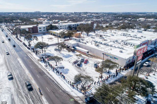 Austin, Texas: People wait in a long line to buy groceries at H-E-B during the extreme cold snap
