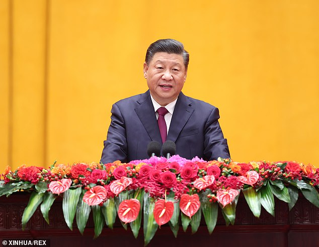 An increasing number of Britons view the rise of China as a critical threat and oppose economic ties to Beijing, a new survey has found. Pictured: President Xi Jinping, addresses a Chinese Lunar New Year reception at the Great Hall of the People in Beijing, China, February 10
