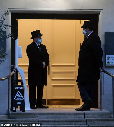 The Duke of Edinburgh reportedly remains in 'good spirits' and is said to have walked unaided into the hospital (pictured: Hospital security staff is seen at the entrance of King Edward VIIs Hospital)