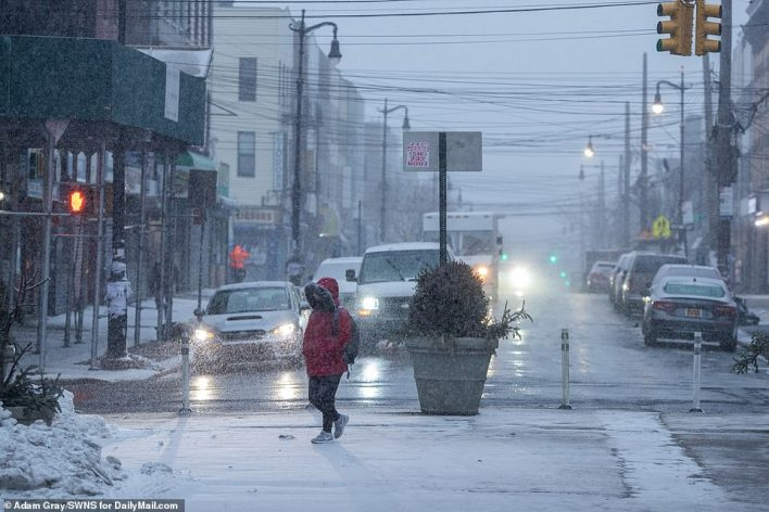 BROOKLYN, NEW YORK: Snowfall began in New York City early Thursday morning. A New Yorker is seen walking in Bushwick, Brooklyn