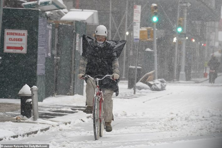 MANHATTAN, NEW YORK: The second part of the storm is forecast to hit the region Thursday evening, forecasters warned. A New Yorker is seen riding a bike in the snow on Thursday