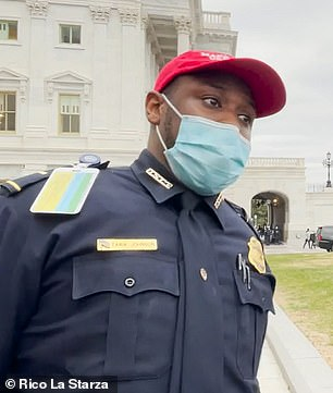 Lt. Tarik Khalid Johnson, 45, who was seen wearing a red 'Make America Great Again' hat as he started directing rioters around the building, has also been suspended