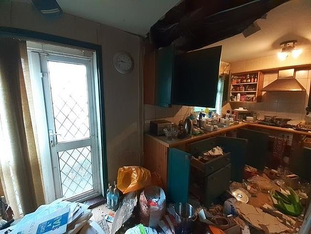 Old wine bottles have been left by the door and while some cupboards have lost their doors, other have managed to remain intact
