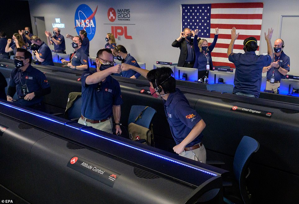 Perseverance beamed back its first image of the crater moments after NASA established radio contact with the rover, leading to raucous applause and joyous scenes at NASA's Californian mission control