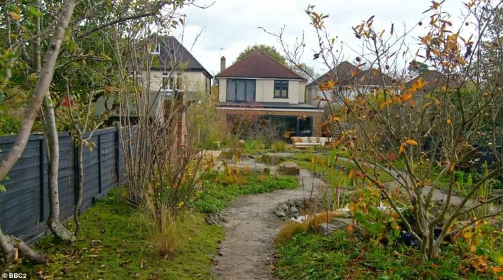Viewers were left less than impressed with the transformation - with several questioning what the paths were made of because they 'look like mud.' Pictured, the garden after the transformation