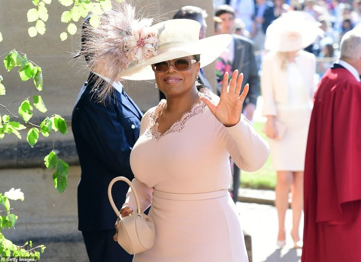 Oprah Winfrey, who is interviewing the couple, is pictured at Harry and Meghan's Windsor Castle wedding on May 19, 2018