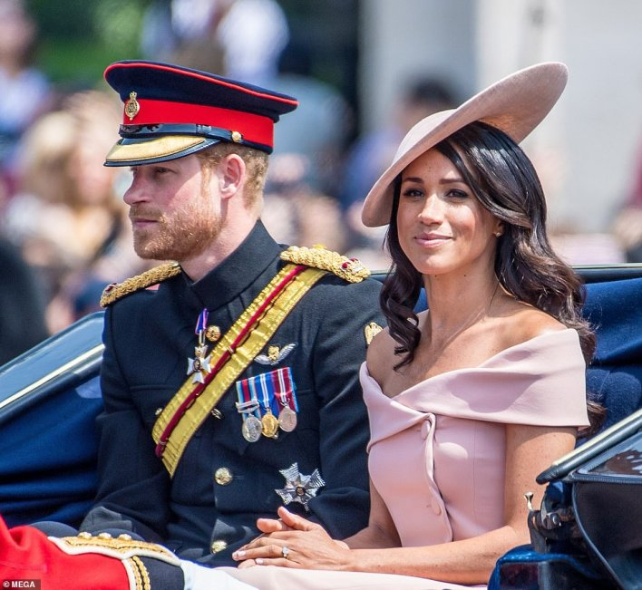 Prince Harry and Meghan Markle attend Trooping the Colour outside Buckingham Palace in London in June 2018