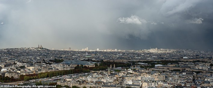 A simply stunning picture of Paris as bruised storm clouds swirl above its streets