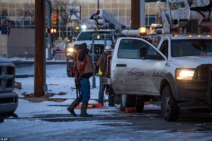 Workmen work in the darkness to try to restore power to hard-hit Texans who have gone six day without power