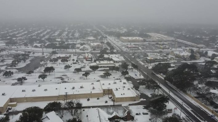 Drone footage over San Antonio shows the area still in darkness. 200,000 homes statewide still have no power