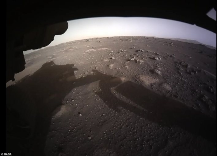 The rover beamed a new image back without the camera lens that shows the Martian landscape in full color