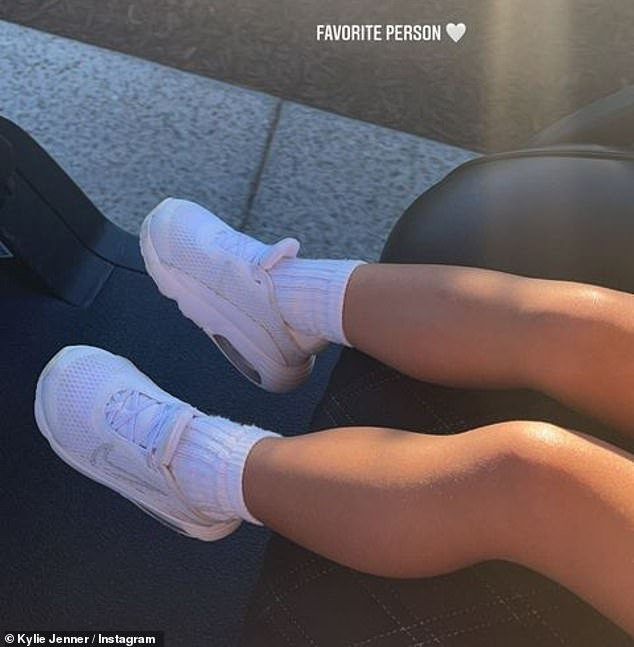 Cool kicks: Kylie later posted a photo of Stormi's cute little legs in a pair of white sneakers, writing: 'Favorite person'