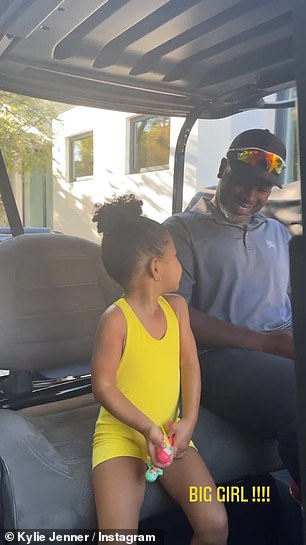 Gang's all here: The 23-year-old shared a video of the toddler, three, sitting in a golf cart with mom Kris Jenner's boyfriend Corey Gamble, 40