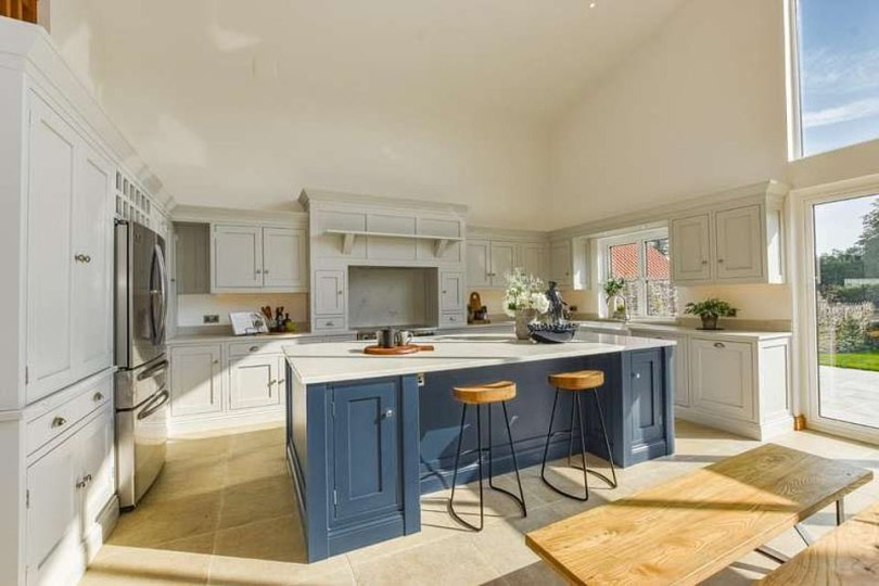 Cosy:In the kitchen Gemma also has plenty of space and cook and entertain her celebrity pals, with granite surfaces, a double sink and a contrasting breakfast bar with blue wood cupboards