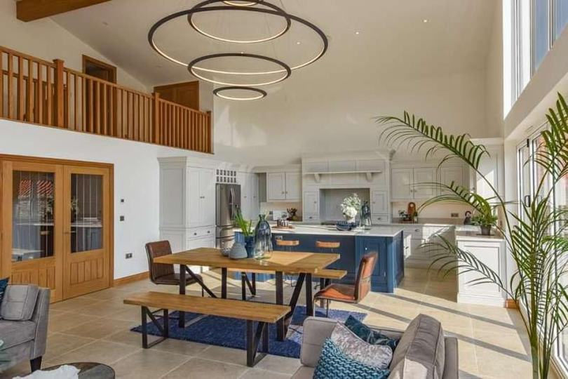 Relaxing: Given the house it converted from a barn, the entire property has a rustic feel, with an open wood finish and floor-to-ceiling windows