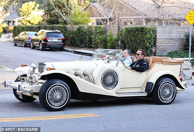 Vroom vroom:The dashing 73-year-old former Governor California was glimpsed driving a male friend around in his throwback Excalibur