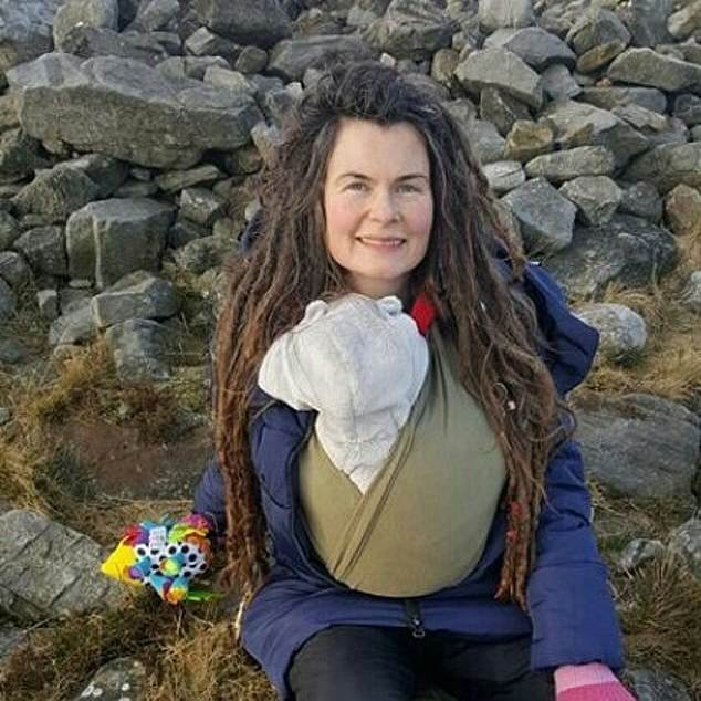 Holly Kobayashi (pictured), then 36, was breastfeeding when she noticed the 5p piece-sized bruise on her son Adventure's arm