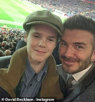 Family business: Naturally, he was seen enjoying a football match with his famous dad