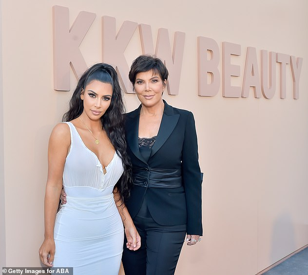 All over the place: After her cosmetics brand took off, Kardashian released a line of perfumes, entitled KKW Fragrance; she is pictured with her mother in 2018