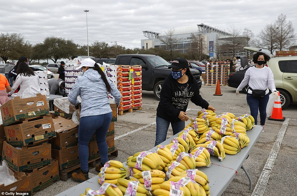 The Houston Food Bank is pictured Sunday.Joe Biden's press secretaryon Sunday confirmed the president may visit Texas 'as soon as this week'