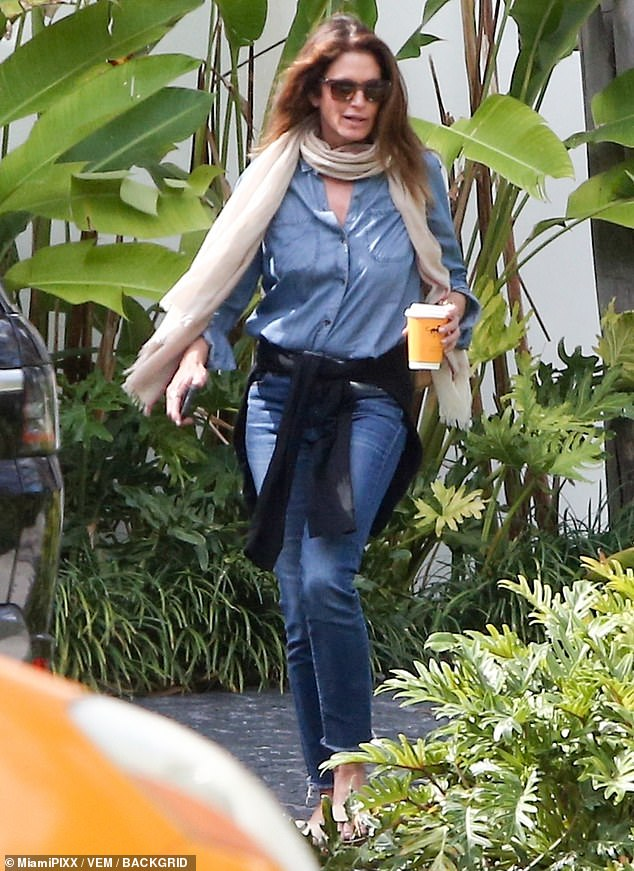 Stepping out: Cindy Crawford was spotted going for a coffee run on Sunday afternoon; her trip comes just after her 55th birthday celebrations