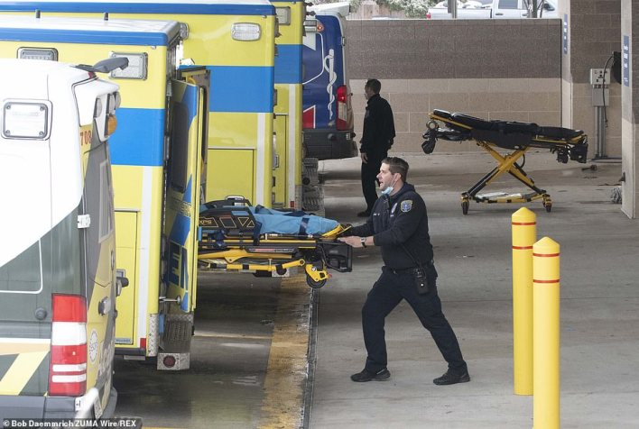 A year into the pandemic, the running total of lives lost in the US was about 498,000 as of Sunday evening