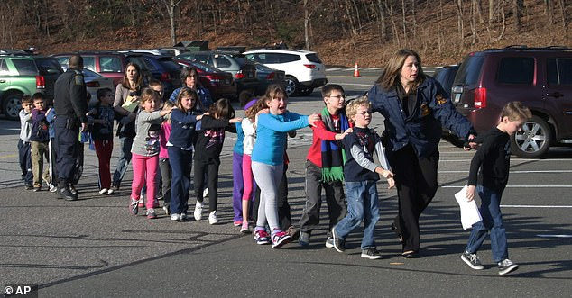 Jones described the Sandy Hook shooting, pictured, in which 26 people, including 20 children between six and seven years old were shot dead, as a 'false flag'.