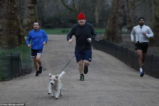Mr Johnson (pictured today running with dog Dilyn in Westminster) will say today that further restrictions will be lifted in subsequent weeks, as long as they meet a set of four new tests designed to keep the pressure off the NHS