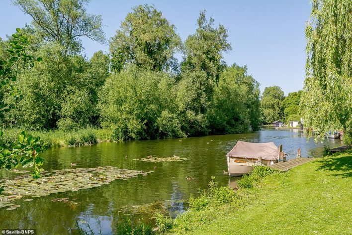 The river bank outside the property.Stephen Christie-Miller, from Savills, said:'The house is ideal for keen boaters, it has a wet boathouse and you can get straight out onto the river from your property'