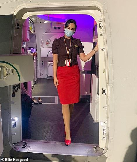 Ellie in her 'standard' pandemic apparel, waiting to greet customers onboard
