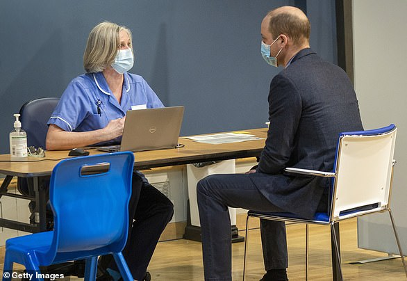William speaks to a nurse at King's Lynn Corn Exchange Vaccination Centre