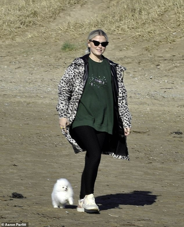 Monday strolls: Lucy Fallon was enjoying the sunny start to the week as she looked cool in an animal print coat while out a walk with her dog Sushi in Blackpool on Monday