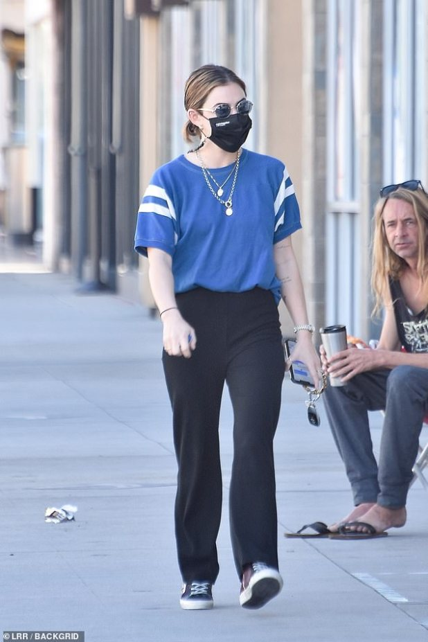 Away from home: Lucy Hale took a break from her hectic work schedule for coffee in Los Angeles on Monday morning.