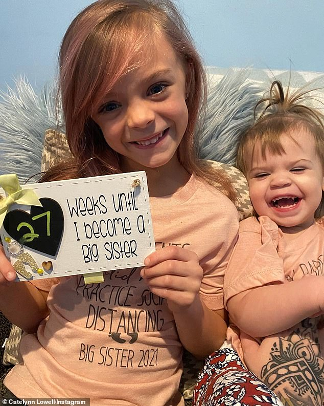 Growing family:The post started off with a photo of her daughter Novalee holding a sign for the camera reading '27 weeks until I become a big sister'