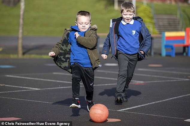Children play a game of football in the playground atWilliamstown Primary School, South Wales