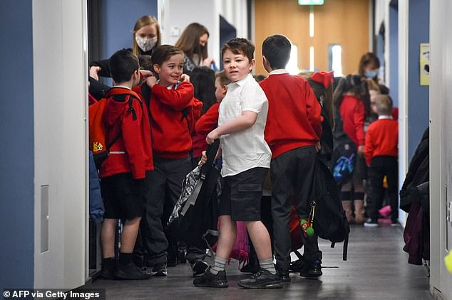 Pupils arrive at Clyde Primary School in Glasgow on February 22, 2021 as schools in Scotland started to reopen to more of the youngest students