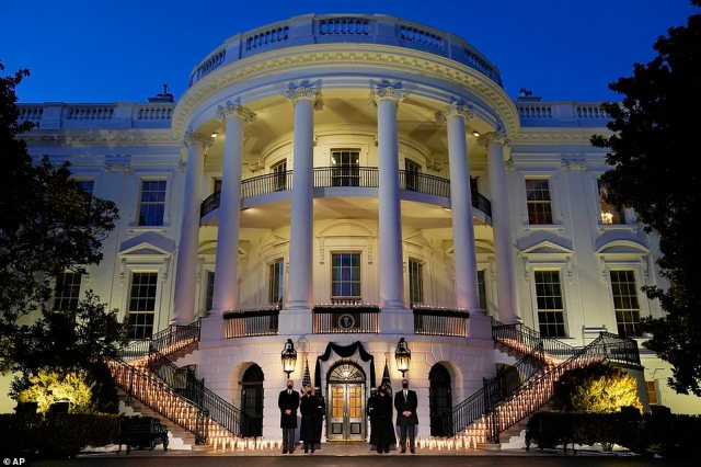 Lit in memory: The South Portico was illuminated by candles for the ceremony of remembrance, and federal flags were lowered to half staff for five days of mourning