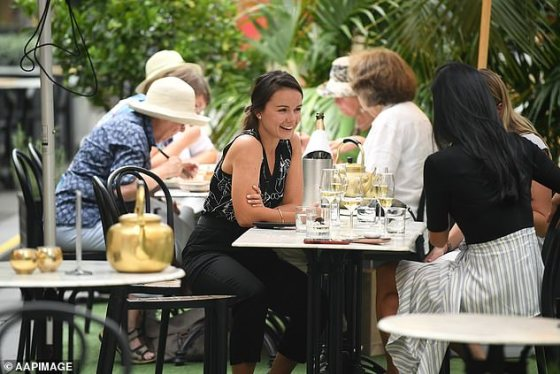 Pictured: Women eating at a restaurant in Sydney on February 12 following rules on wearing a resting mask