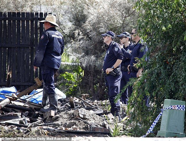 Officers were particularly interested in a yellow canister that was pulled from the wreckage