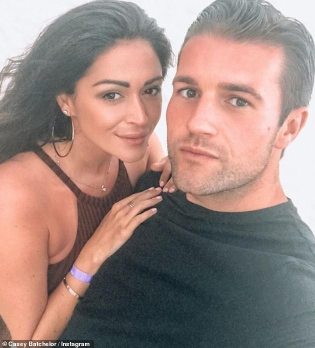 Three under three: Casey pictured with fiance Dane Goodson, 32