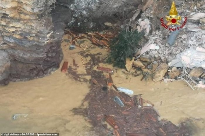 Pictures from the scene showed coffins in the water among the debris, some 160 feet below the top of the cliff