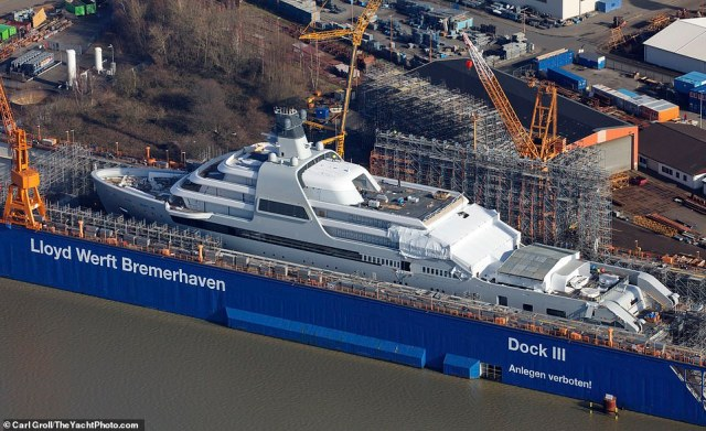 The colossal boat was pictured surrounded by scaffolding and cranes at the end of December as she neared completion at the Lloyd Werft shipyard in Bremerhaven, north of Bremen