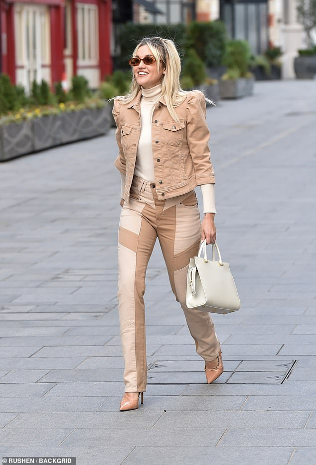 Strutting it fine: Ashley looked chirpy as she strutted to work, adding tortoiseshell shades and carrying a cream purse
