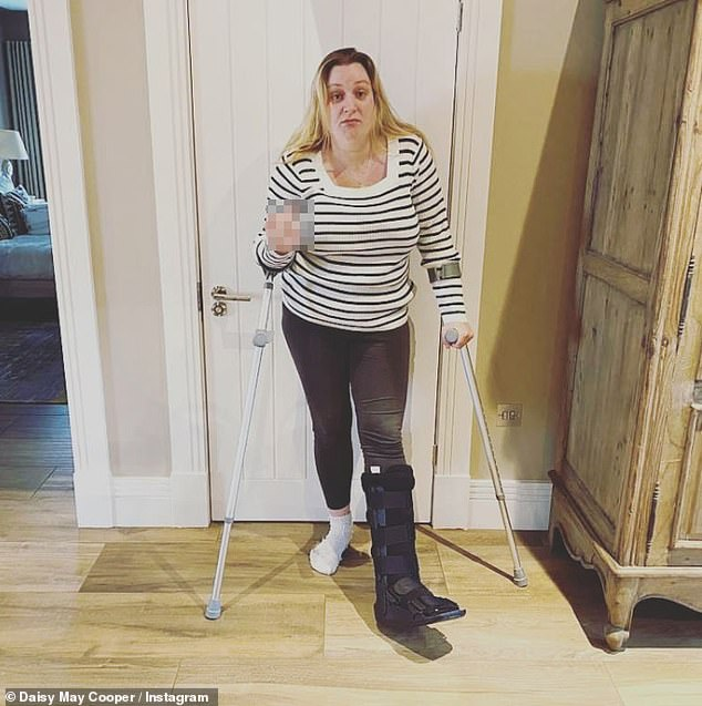 Injured: Daisy May Cooper suffered a mysterious foot injury, posing on crutches while wearing an orthopedic boot for an Instagram photo on Tuesday