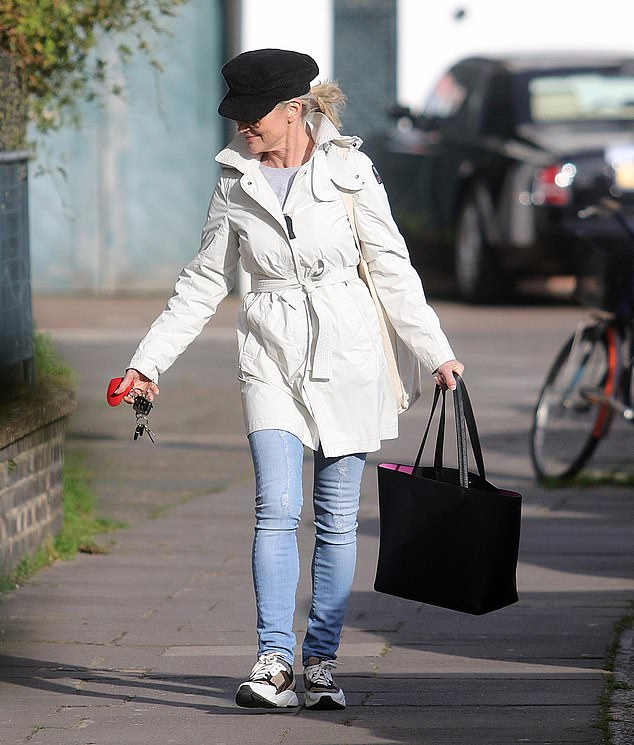 Defiant display: But Anthea brushed off the criticism and flashed a smile as she headed out for a stroll in the capital