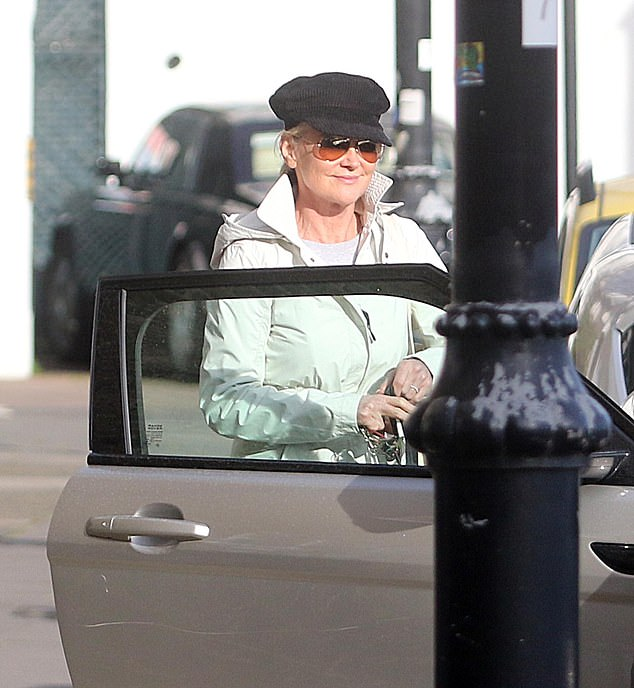 Out and about: The television personality was spotted getting into her car