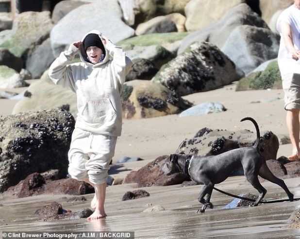 Simple: The teenage icon looked ultra comfy yet stylish in a matching cream-colored tracksuit, whose pants she hiked for a run in the breaking waves