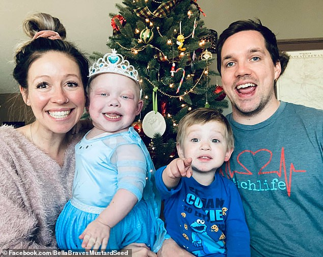 Isabella is currently battling three rare conditions that have left her living in the hospital since birth. Pictured: Isabella (second from left) with her parents and younger brother